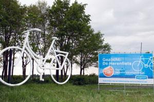 Unigarant schenkt tipgeld voor gestolen kunstwerk 'De Herenfiets' aan KWF Kankerbestrijding