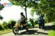 55823591 3589479 emco e scooter rijdend  zijkant  met logo 80x53